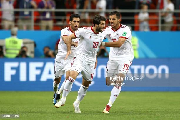 Karim Ansarifard of Iran celebrates with teammates Vahid Amiri and Majid Hosseini after scoring his team's first goal during the 2018 FIFA World Cup...