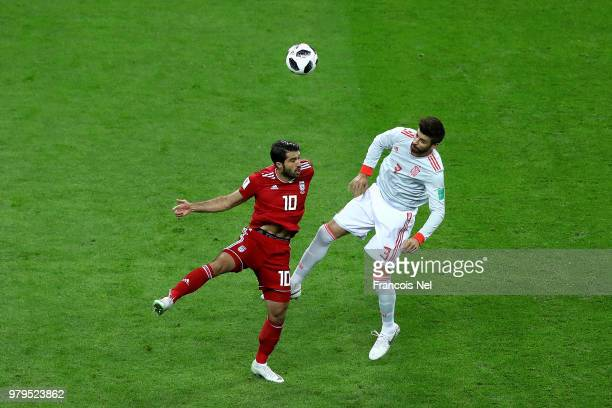 Sergio Ramos of Spain and Sardar Azmoun of Iran and Gerad Pique in action during the 2018 FIFA World Cup Russia group B match between Iran and Spain...