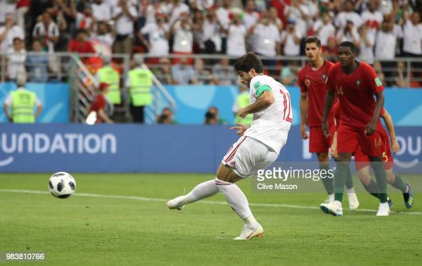 Karim Ansarifard of Iran scores his team's first goal from the peanlty spot during the 2018 FIFA World Cup Russia group B match between Iran and...