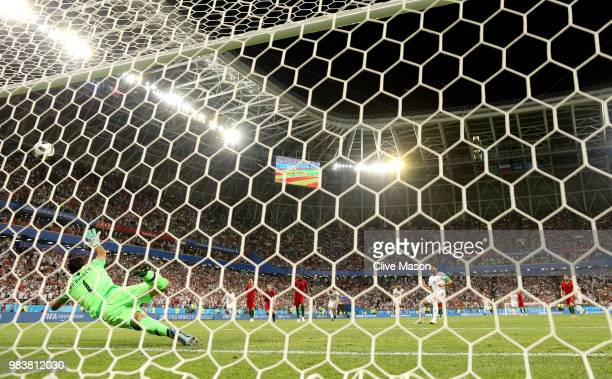 Karim Ansarifard of Iran scores past Rui Patricio of Portugal his team's first goal from the peanlty spot during the 2018 FIFA World Cup Russia group...
