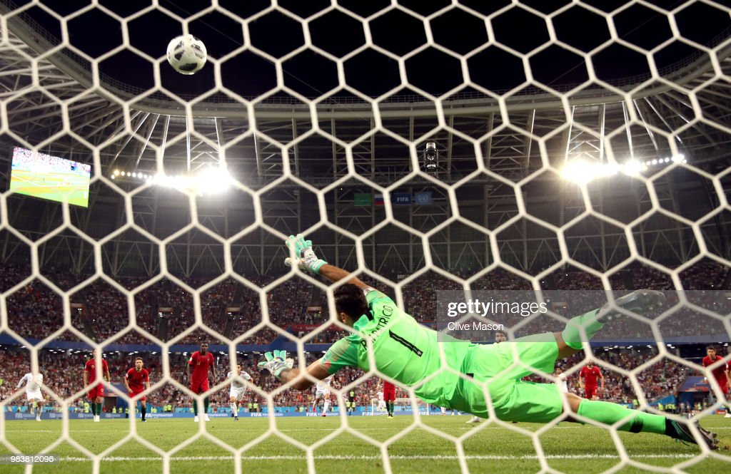 Karim Ansarifard of Iran scores past Rui Patricio of Portugal his team's first goal from the peanlty spot during the 2018 FIFA World Cup Russia group B match between Iran and Portugal at Mordovia Arena on June 25, 2018 in Saransk, Russia.