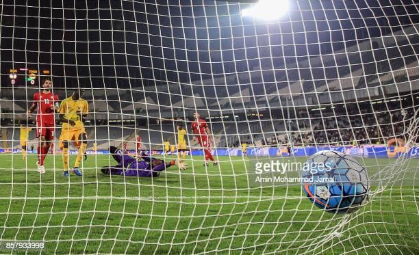 Karim Ansarifard of Iran scores the opening goal during the international friendly match between Iran and Togo at Azadi Stadium on October 5 2017 in...
