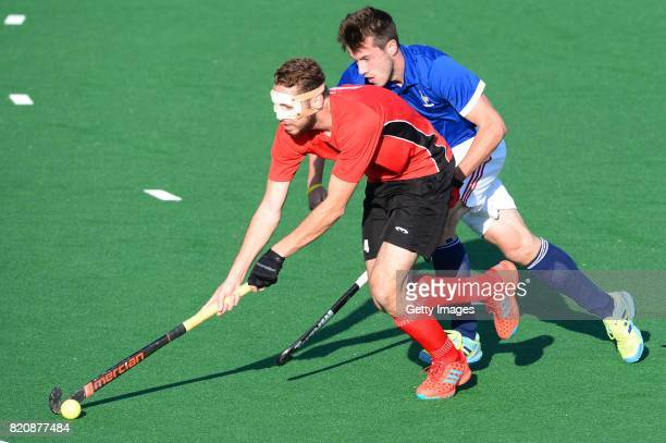 Karim Atef of Egypt and Etienne Tynevez of France during day 8 of the FIH Hockey World League Men's Semi Finals 7th8th place match between Egypt and...