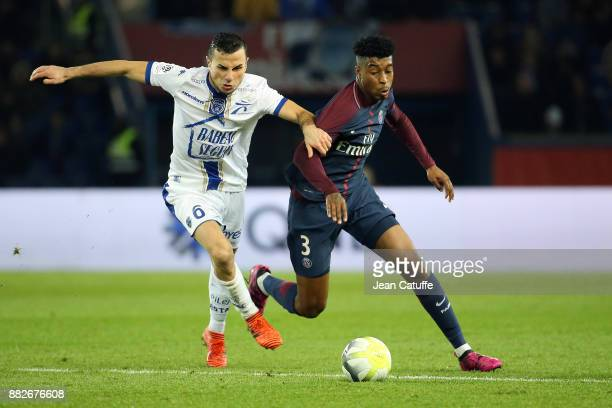 Karim Azamoum of Troyes Presnel Kimpembe of PSG during the French Ligue 1 match between Paris Saint Germain and Troyes ESTAC at Parc des Princes on...