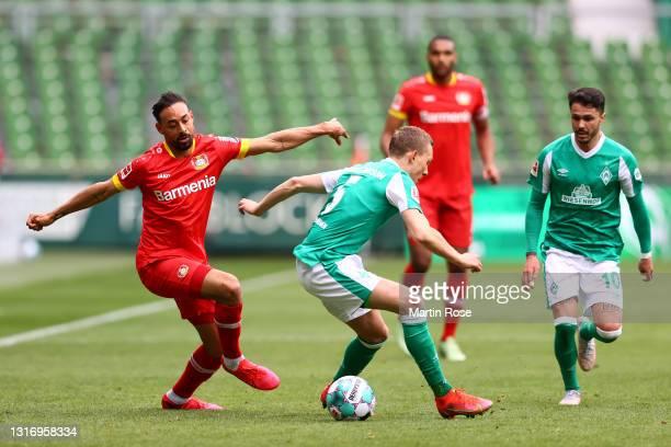 Karim Bellarabi of Bayer 04 Leverkusen battles for possession with Ludwig Augustinsson of SV Werder Bremen during the Bundesliga match between SV...