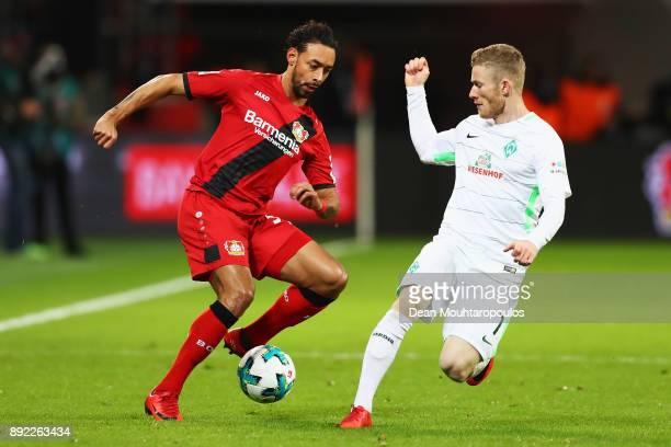 Karim Bellarabi of Bayer 04 Leverkusen battles for the ball with Florian Kainz of Werder Bremen during the Bundesliga match between Bayer 04...