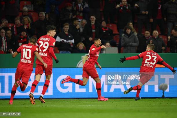 Karim Bellarabi of Bayer 04 Leverkusen celebrates with teammate MitchellElijah Weiser after socring his sides first goal during the DFB Cup...