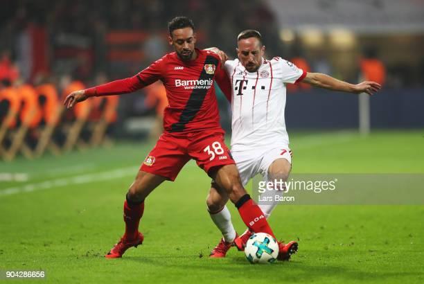 Karim Bellarabi of Bayer Leverkusen and Franck Ribery of Bayern Muenchen battle for the ball during the Bundesliga match between Bayer 04 Leverkusen...