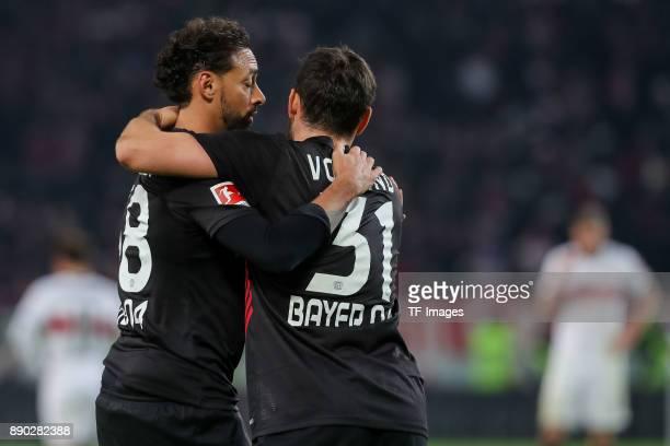 Karim Bellarabi of Bayer Leverkusen and Kevin Volland of Bayer Leverkusen celebrate after winning the Bundesliga match between VfB Stuttgart and...