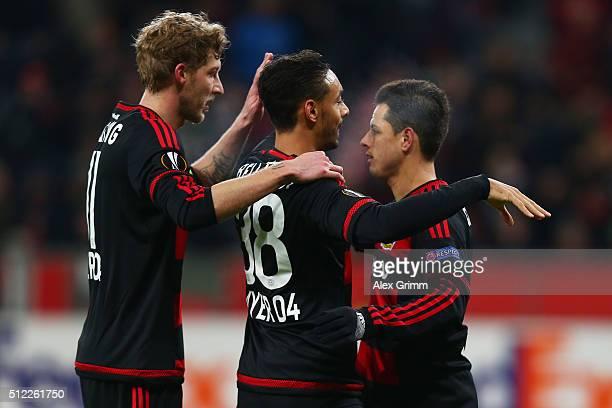 Karim Bellarabi of Bayer Leverkusen celebrates scoring his team's first goal with his team mate Stephan Kiessling and Javier Hernandez during the...