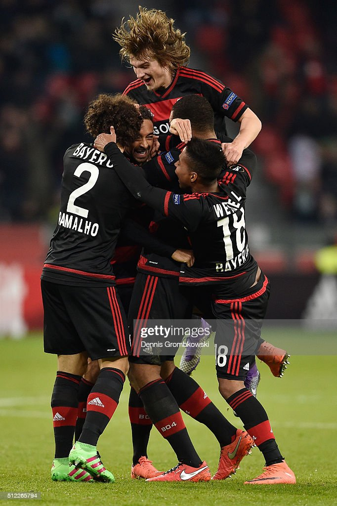 Karim Bellarabi (2nd L) of Bayer Leverkusen celebrates scoring his team's second goal with his team mates during the UEFA Europa League round of 32 second leg match between Bayer Leverkusen and Sporting Lisbon at BayArena on February 25, 2016 in Leverkusen, Germany.