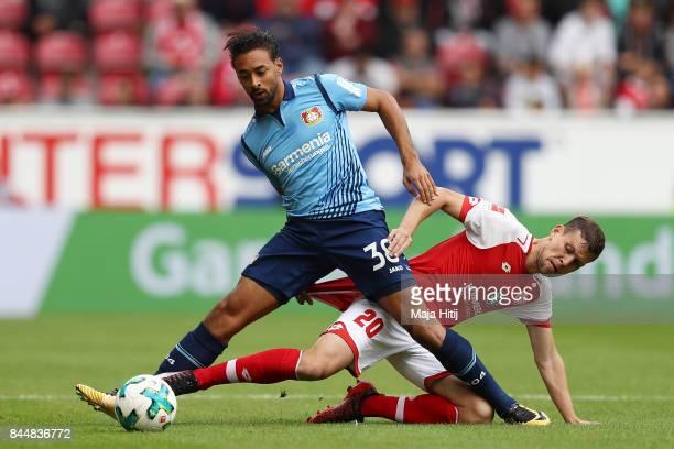 Karim Bellarabi of Bayer Leverkusen fights for the ball with Fabian Frei of Mainz during the Bundesliga match between 1 FSV Mainz 05 and Bayer 04...