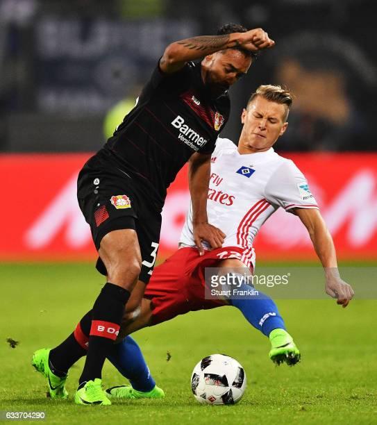 Karim Bellarabi of Bayer Leverkusen is challenged by Matthias Ostrzolek of Hamburger SV during the Bundesliga match between Hamburger SV and Bayer 04...
