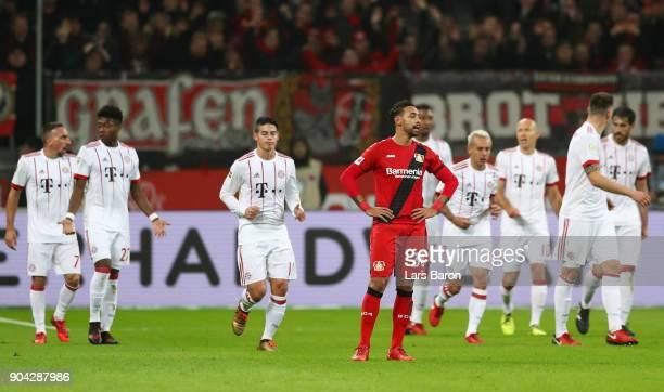 Karim Bellarabi of Bayer Leverkusen look dejected as Javi Martinez of Bayern Muenchen scores their first goal during the Bundesliga match between...