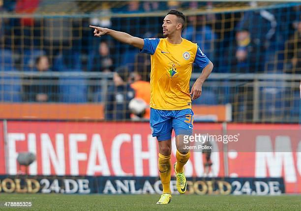 Karim Bellarabi of Braunschweig celebrates after scoring his team's first goal during the Bundesliga match between Eintracht Braunschweig and VfL...