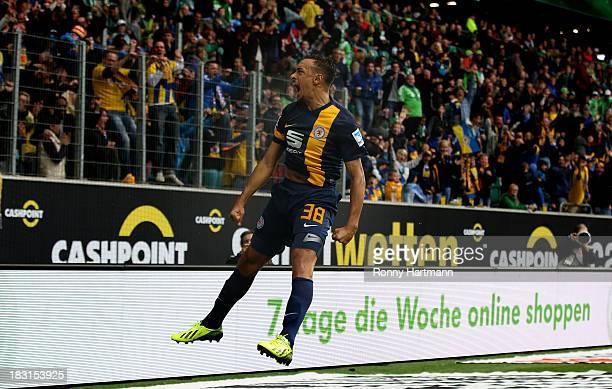 Karim Bellarabi of Braunschweig celebrates scoring his team's opening goal during the Bundesliga match between VfL Wolfsburg and Eintracht...