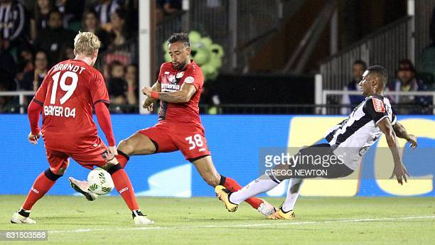 Karim Bellarabi of German club Bayer 04 Leverkusen clears a challenge by Nathanael Ananias of Brazilian club Atletico during their Florida Cup soccer...