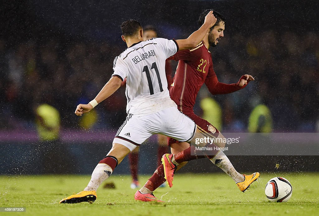 Karim Bellarabi (L) of Germany and Isco (R) of Spain compete for the ball during the International Friendly match between Spain and Germany at Estadio Balaidos on November 18, 2014 in Vigo, Spain.