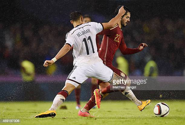 Karim Bellarabi of Germany and Isco of Spain compete for the ball during the International Friendly match between Spain and Germany at Estadio...