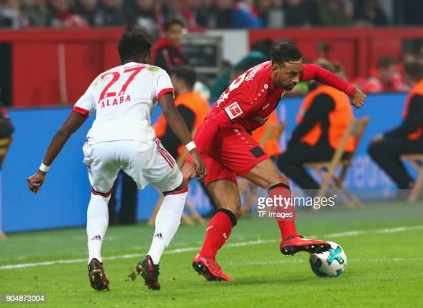 Karim Bellarabi of Leverkusen and David Alaba of Muenchen battle for the ball during the Bundesliga match between Bayer 04 Leverkusen and FC Bayern...