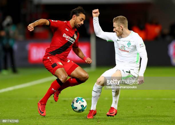 Karim Bellarabi of Leverkusen and Florian Kainz of Bremen battle for the ball during the Bundesliga match between Bayer 04 Leverkusen and SV Werder...