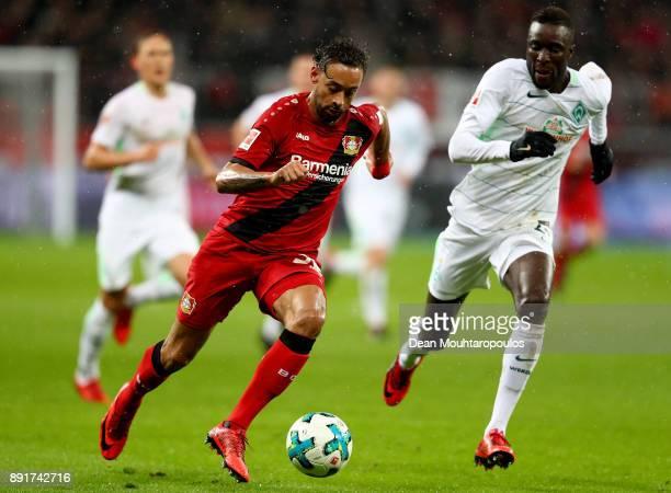 Karim Bellarabi of Leverkusen and Ludovic Sane of Bremen battle for the ball during the Bundesliga match between Bayer 04 Leverkusen and SV Werder...