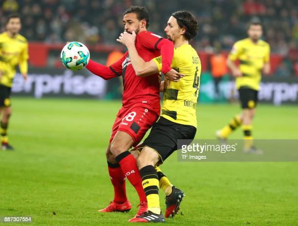 Karim Bellarabi of Leverkusen and Neven Subotic of Dortmund battle for the ball during the Bundesliga match between Bayer 04 Leverkusen and Borussia...