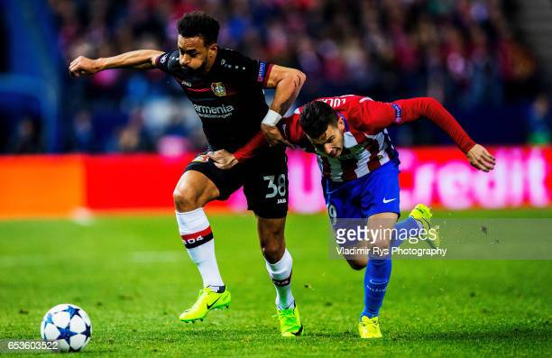 Karim Bellarabi of Leverkusen battles for the ball with Lucas Hernandez of Atletico during the UEFA Champions League Round of 16 second leg match...