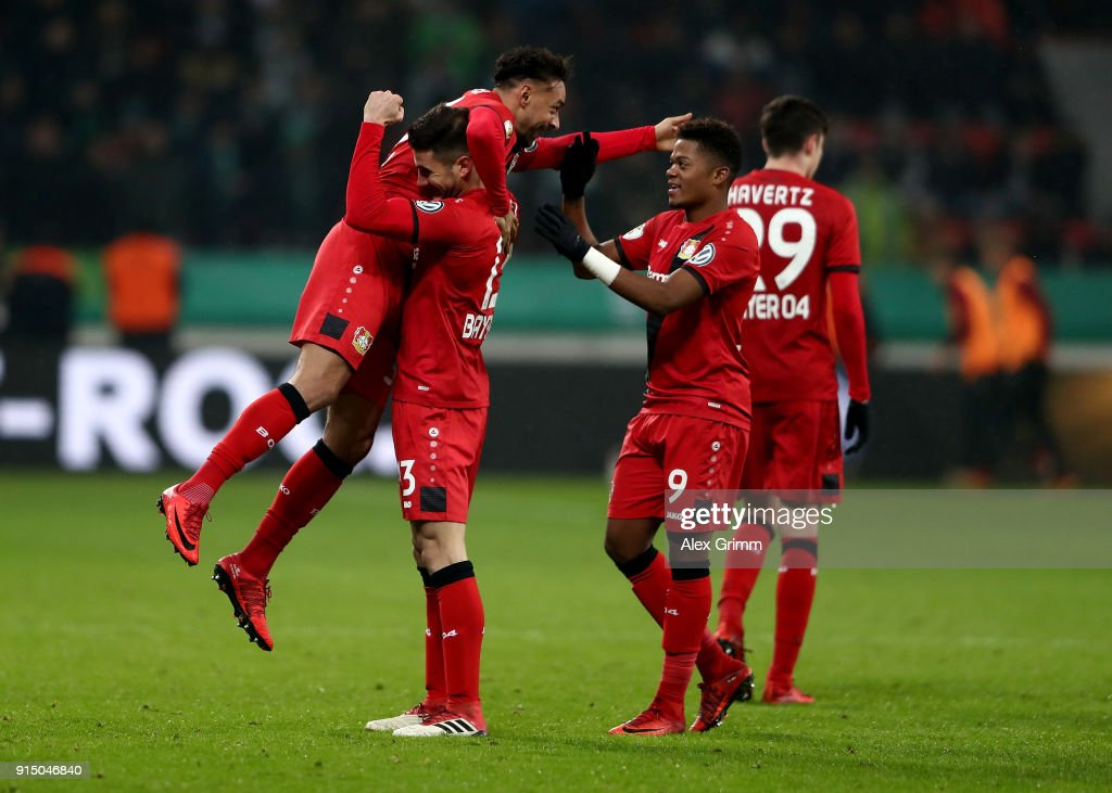 Karim Bellarabi (L) of Leverkusen celebrate with his team mates after he scores the 3rd goal during extzra time during the DFB Cup quarter final match between Bayer Leverkusen and Werder Bremen at BayArena on February 6, 2018 in Leverkusen, Germany.