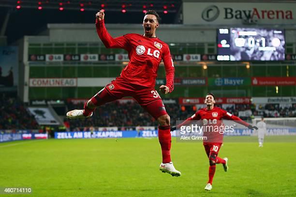 Karim Bellarabi of Leverkusen celebrates his team's first goal with team mates Hakan Calhanoglu during the Bundesliga match between Bayer 04...