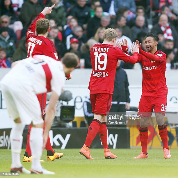 Karim Bellarabi of Leverkusen celebrates his team's second goal with team mates Julian Brandt and Stefan Kiessling during the Bundesliga match...