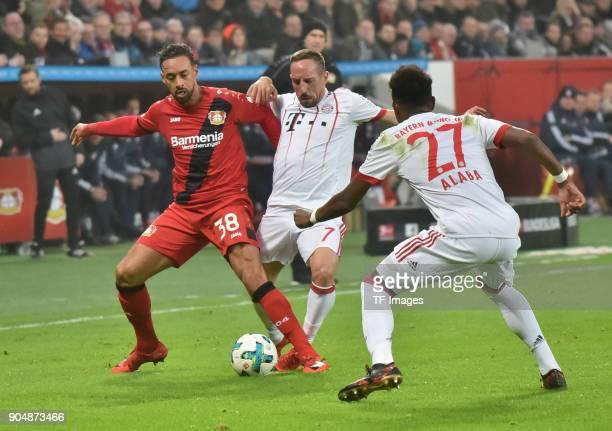 Karim Bellarabi of Leverkusen Franck Ribery of Muenchen and David Alaba battle for the ball during the Bundesliga match between Bayer 04 Leverkusen...
