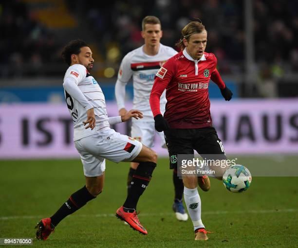 Karim Bellarabi of Leverkusen is challenged by Iver Fossum of Hannover during the Bundesliga match between Hannover 96 and Bayer 04 Leverkusen at...