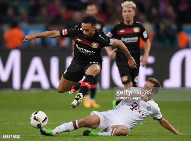 Karim Bellarabi of Leverkusen is challenged by Philipp Lahm of FC Bayern Muenchen during the Bundesliga match between Bayer 04 Leverkusen and Bayern...