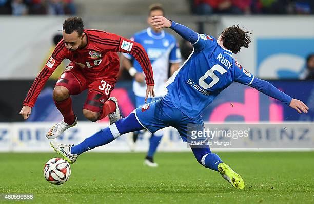 Karim Bellarabi of Leverkusen is challenged by Sebastian Rudy of Hoffenheim during the Bundesliga match between 1899 Hoffenheim and Bayer 04...
