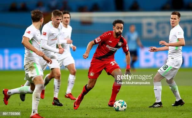 Karim Bellarabi of Leverkusen runs into the defence of Bremen battle for the ball during the Bundesliga match between Bayer 04 Leverkusen and SV...