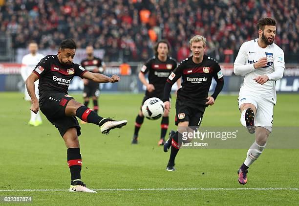Karim Bellarabi of Leverkusen shots as he plays his first game since being injured for a long period during the Bundesliga match between Bayer 04...