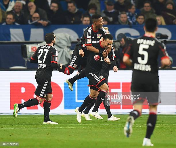 Karim Bellarbi of Bayer 04 Leverkusen is congratulated after scoring the first goal during the Bundesliga match between FC Schalke 04 and Bayer 04...
