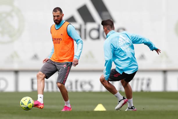 Karim Benzema and Antonio Blanco both of Real Madrid are training at Valdebebas training ground on May 15, 2021 in Madrid, Spain.