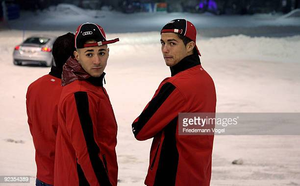 Karim Benzema and Cristiano Ronaldo looks on during the Audi Car Handover and Snow Driving Experience with Real Madrid at the Snowzone on October 26...