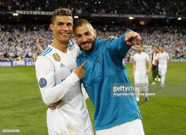 Karim Benzema and Cristiano Ronaldo of Real Madrid celebrate after the UEFA Champions League Semi Final Second Leg match between Real Madrid and...