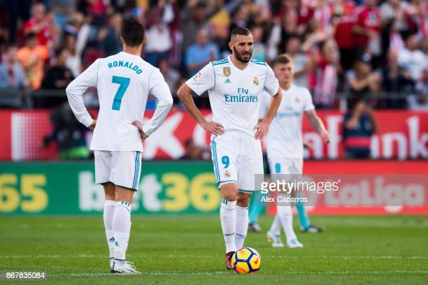 Karim Benzema and Cristiano Ronaldo of Real Madrid CF react after Cristian 'Portu' of Girona FC scored his team's second goal during the La Liga...