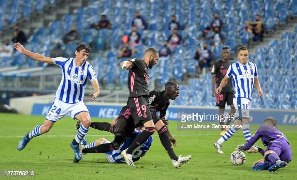 Karim Benzema and Ferland Mendy of Real Madrid are challenged by Aritz Elustondo and Robin Le Normand of Real Sociedad during the La Liga Santander...