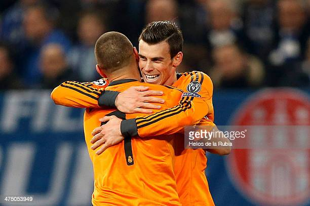 Karim Benzema and Gareth Bale of Real Madrid celebrate after scoring during the UEFA Champions League Round of 16 first leg match between FC Schalke...