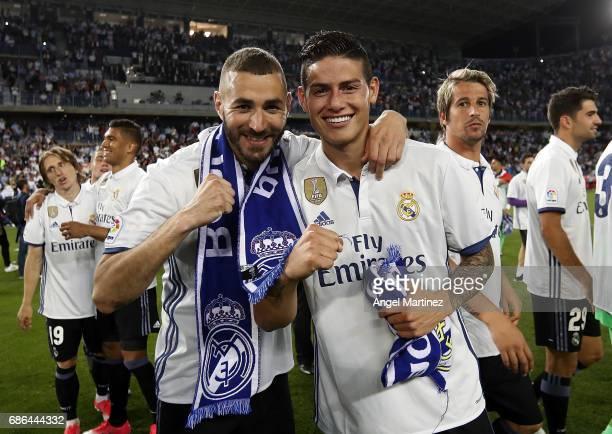 Karim Benzema and James Rodriguez of Real Madrid celebrate winning the La Liga title following the La Liga match between Malaga CF and Real Madrid CF...