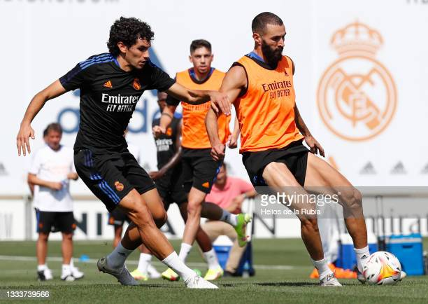 Karim Benzema and Jesús Vallejo both of Real Madrid are training with Federico Valverde at Valdebebas training ground on August 12, 2021 in Madrid,...