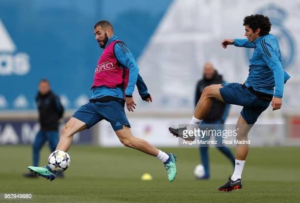 Karim Benzema and Jesus Vallejo of Real Madrid in action during a training session at Valdebebas training ground on April 30 2018 in Madrid Spain
