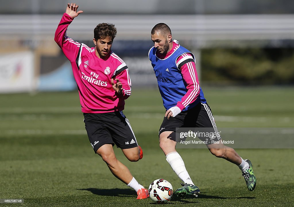 Karim Benzema (R) and Lucas Silva of Real Madrid in action during a training session at Valdebebas training ground on March 4, 2015 in Madrid, Spain.