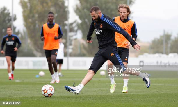 Karim Benzema and Luka Modric of Real Madrid are training at Valdebebas training ground on October 16, 2021 in Madrid, Spain.