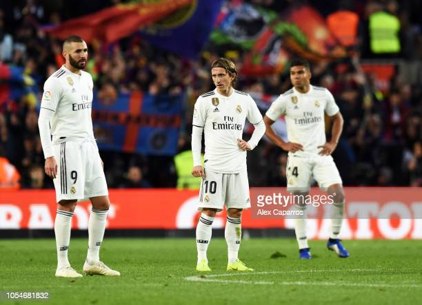 Karim Benzema and Luka Modric of Real Madrid look dejected during the La Liga match between FC Barcelona and Real Madrid CF at Camp Nou on October 28...